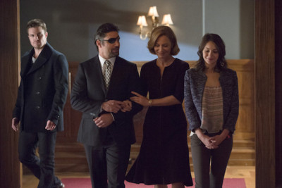 "Arrow -- ""The Promise"" -- Image AR215a_0356b -- Pictured (L-R): Stephen Amell as Oliver Queen, Manu Bennett as Slade Wilson, Susanna Thompson as Moira Queen and Willa Holland as Thea Queen -- Photo: Cate Cameron/The CW -- © 2014 The CW Network, LLC. All Rights Reserved."