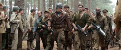 "Chris Evans plays Steve Rogers (center) with the Howling Commandos - Bruno Ricci plays Jacques Dernier (third left from center), Kenneth Choi plays Jim Morita (second left from center), Neal McDonough plays Dum Dum Dugan (first right from center), Sebastian Stan plays James ""Bucky"" Barnes (second right from center), JJ Feild plays Montgomery Falsworth (third right from center), and Derek Luke plays Gabe Jones (fifth right from center) - in CAPTAIN AMERICA: THE FIRST AVENGER, from Paramount Pictures and Marvel Entertainment."